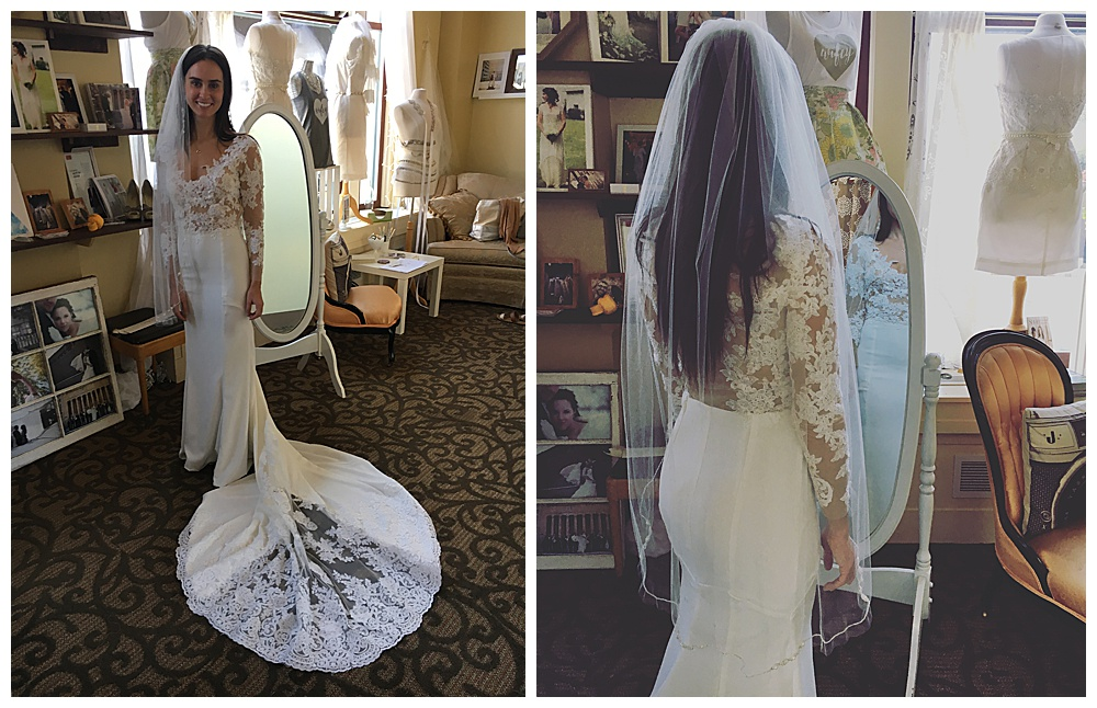 The bride smiles in our office space with her veil on and her train on full display (left) The upper half of the bride's long sleeve lace wedding gown and veil are on display as she faces our full length mirror.