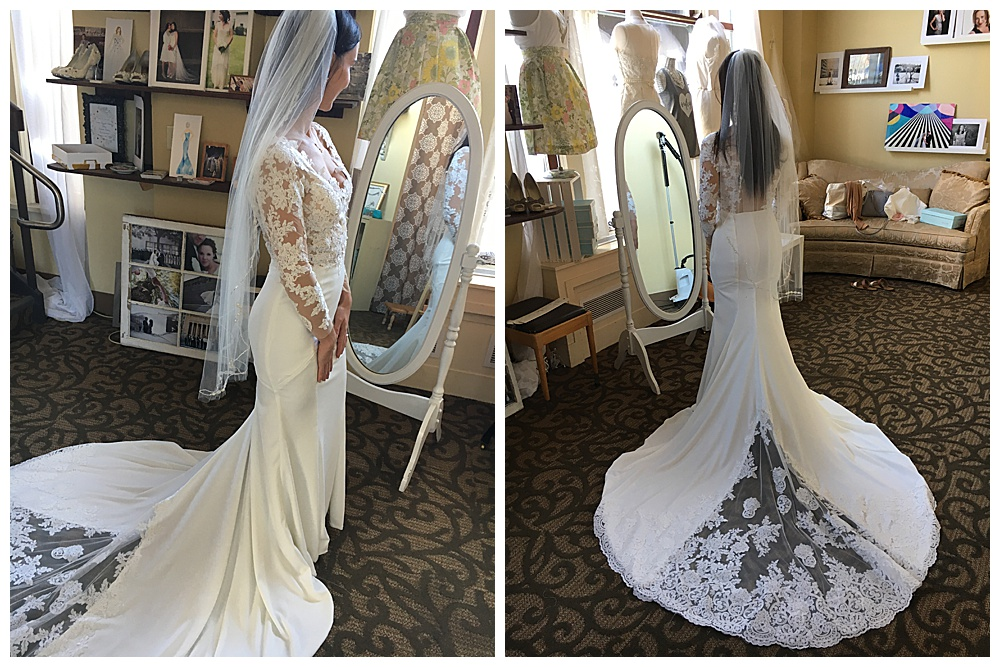 The bride shows off a sideview of her finished handmade long sleeve lace wedding gown with her veil on (left) then a photo of the back of the dress with the custom train on display in our office (right).