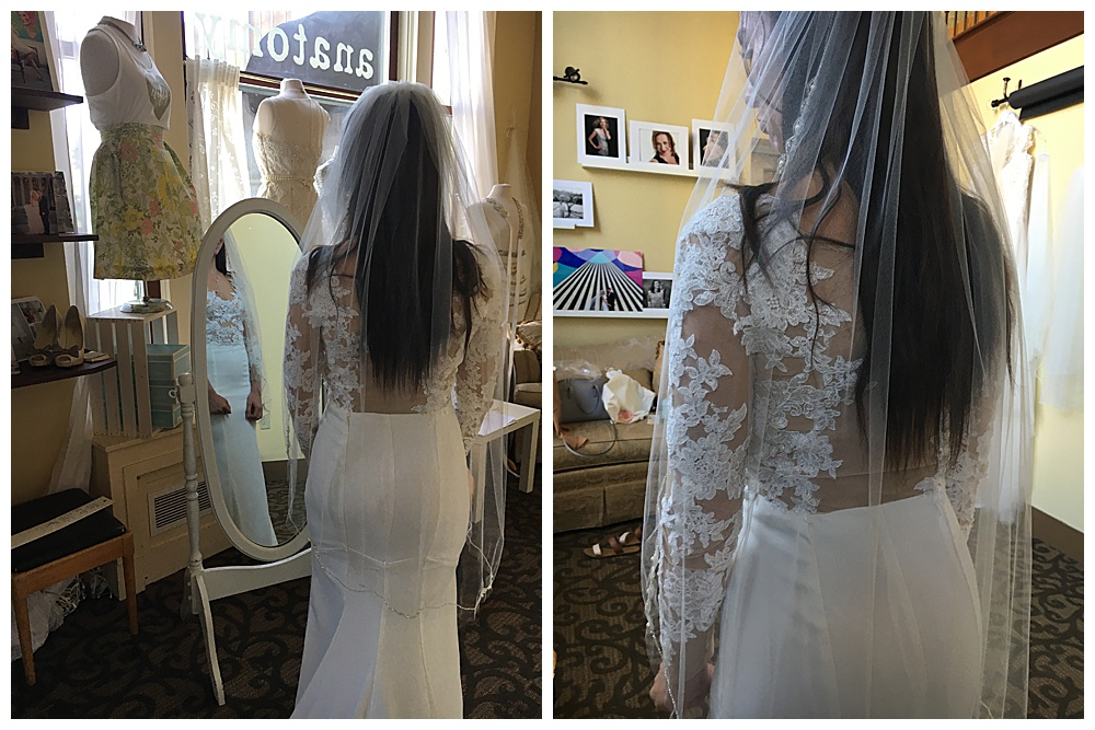The bride's long sleeve lace wedding gown back is on display as the front peeps through the mirror in our office (left) The second photo is a close up look of the handmade long sleeve lace.