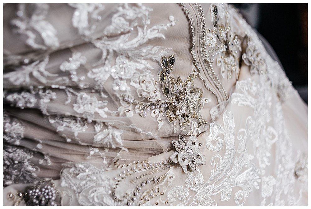 Another closeup of the intricate lace appliqué detailing that goes into creating made-to-measure wedding dresses.