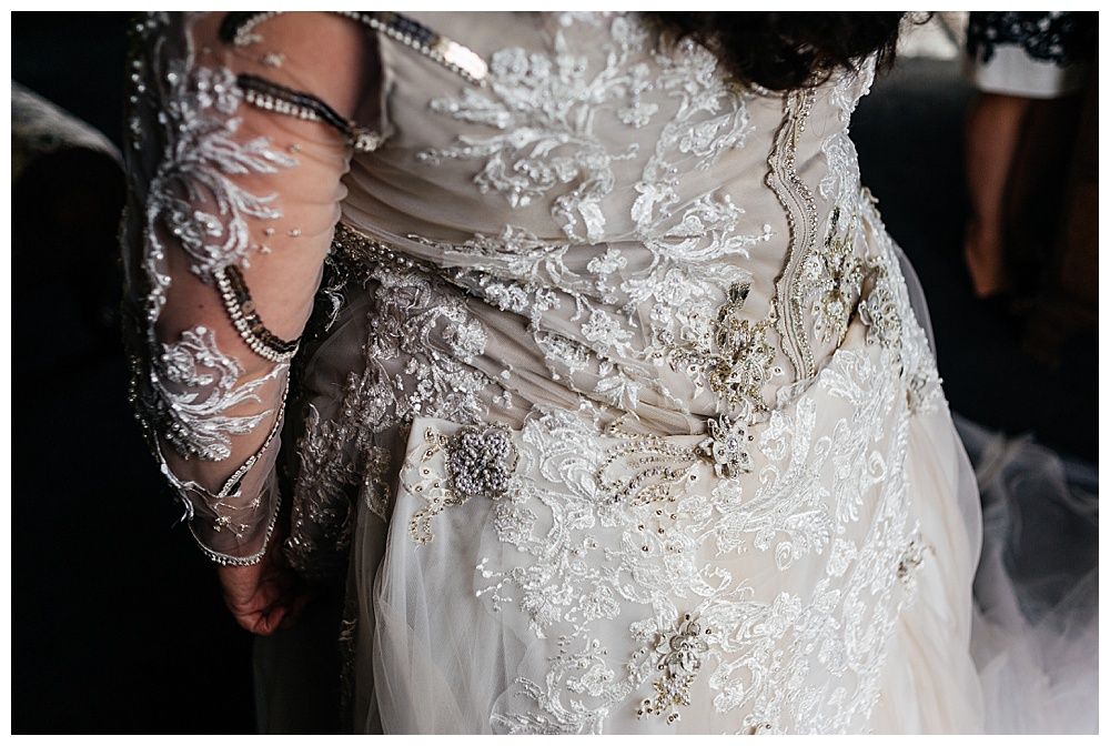 Close up of the back of the dress to see the lace appliqué detailing for the custom lace wedding dress we made for our Buffalo bride.