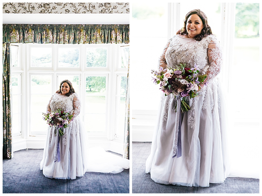 Our bride poses in her custom soft purple lace wedding dress.