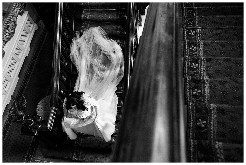 Overhead view of the bride walking with the custom detachable train on full display.