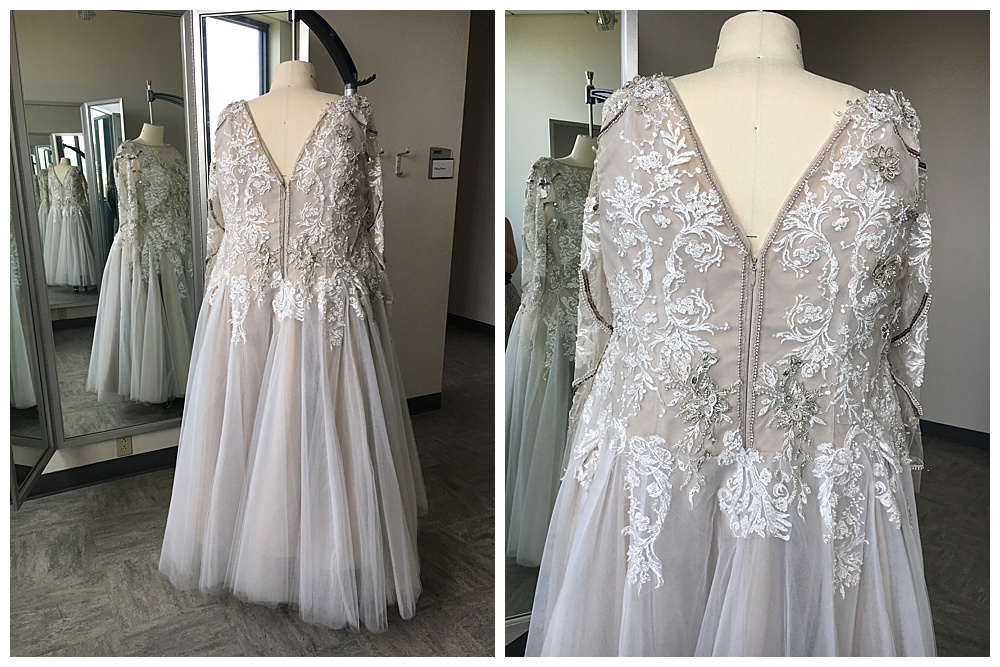 The back of the custom lace wedding dress, showing the  silver trim detail around the neckline zipper.
