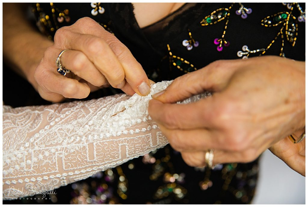 Close up of the lace appliqué on the bride's sleeve for Natalie's custom geometric wedding dress