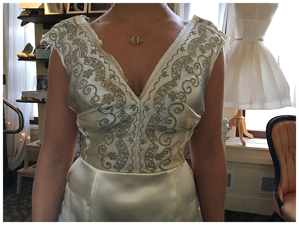Closeup of the unfinished bodice for our heirloom wedding dress reconstruction.